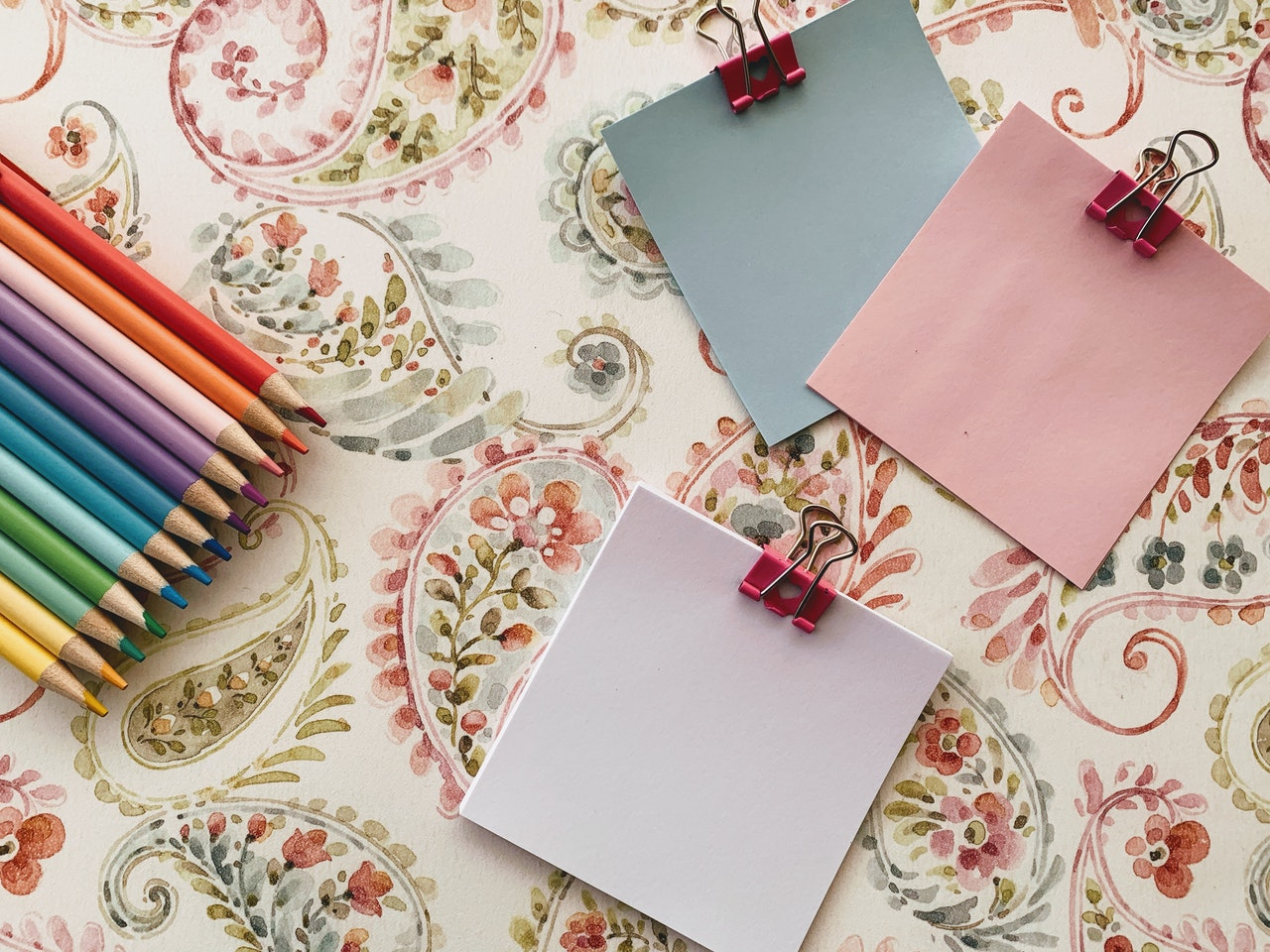 pink papers with colored pencils