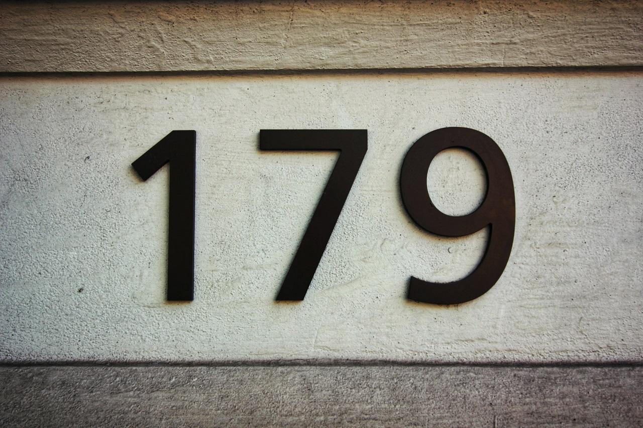 street numbers embossed on stone