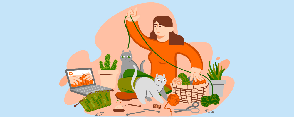 woman with yarns with two cats
